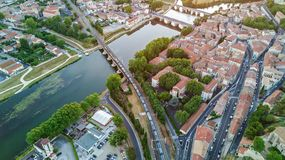 Aerial top view of Beziers town, river and bridges from above, France. Aerial top view of Beziers town, river and bridges from above, South Francen Stock Photos