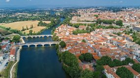 Aerial top view of Beziers town, river and bridges from above, France. Aerial top view of Beziers town, river and bridges from above, South Francen Stock Images
