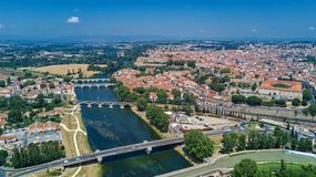 Aerial top view of Beziers town, river and bridges from above, France. Aerial top view of Beziers town, river and bridges from above, South Francen Stock Photo