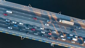 Aerial top view of bridge road automobile traffic jam of many cars from above, city transportation Stock Photos