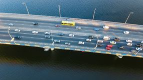 Aerial top view of bridge road automobile traffic jam of many cars from above, city transportation Royalty Free Stock Photography