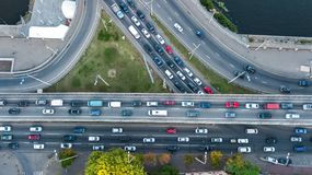 Aerial top view of bridge road automobile traffic jam of many cars from above, city transportation Royalty Free Stock Photo