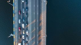 Aerial top view of bridge road automobile traffic jam of many cars from above, city transportation Stock Photo