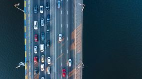 Aerial top view of bridge road automobile traffic jam of many cars from above, city transportation. Concept Royalty Free Stock Image