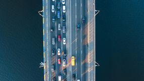 Aerial top view of bridge road automobile traffic jam of many cars from above, city transportation Royalty Free Stock Photos
