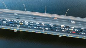 Aerial top view of bridge road automobile traffic jam of many cars from above, city transportation Stock Image
