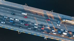 Aerial top view of bridge road automobile traffic jam of many cars from above, city transportation Royalty Free Stock Images