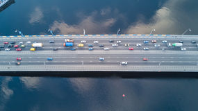 Aerial top view of bridge road automobile traffic of many cars, transportation Stock Image