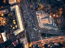 Aerial top view of city asphalt road with lot of vehicles or car traffic and buildings, modern urban intersections and junctions stock photos