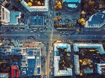 Aerial top view of city asphalt roads with lot of vehicles or car traffic and buildings, modern urban intersections and junctions stock photography
