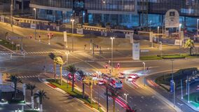 Top view city traffic on a crossroad in Dubai Business bay night timelapse.
