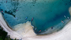 Aerial top view of clear blue sea in summer time on the tropical island. Koh Phangan, Thailand, clear blue sea in coral reef bay from top view Royalty Free Stock Images