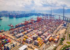 Aerial top view of container cargo ship in the export and import business and logistics international goods in urban city. royalty free stock photography
