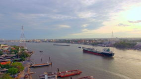 Aerial top view of container transportation ship on chao phraya river at twilight or evening time, transportation concept, trackin stock video