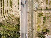 Aerial top view of countryside isolated road with railway tracks f royalty free stock photo