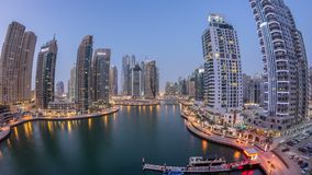 Beautiful aerial top view day to night transition timelapse of Dubai Marina canal. Aerial top view day to night transition timelapse of Dubai Marina promenade stock video footage