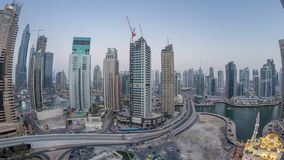 Beautiful aerial top view day to night transition timelapse of Dubai Marina canal. Aerial top view day to night transition timelapse of Dubai Marina promenade stock video