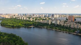 Aerial top view from drone on cityscape, skyline and coastline. Aerial top view from drone on cityscape, skyline and coastline of Dnieper River near Rusanivka royalty free stock photo