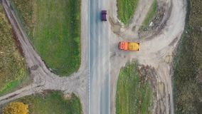 Aerial top view from drone on a heavy truck with sand