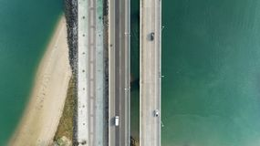 Aerial top view drone shot of bridge with cars on bridge road image transportation background concept.  stock photos
