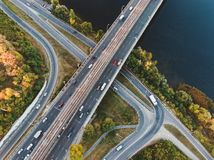 Aerial or top view from drone to road junction, freeway and bridge and car traffic in big city, urban transportation concept stock photos