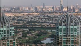 Aerial top view of Dubai Marina evening timelapse. Skyscrapers during sunset in Dubai, UAE. Golf course on a background stock footage
