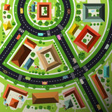 Aerial Top View Flat Design Vector. Abstract Green City Map with Streets, Houses, Cars and People Stock Photos