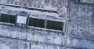 Football field at winter. Aerial top view of the football field in town at winter stock video