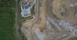 Aerial top view of the garbage dump and waste management plant. Copter flying over the big pile of trash. Dirty earth outside the city, ecological damage stock footage