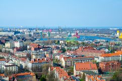 Aerial top view of Gdansk city, port cranes, plants, buildings from view platform of Basilica St Marys church cathedral and Baltic stock photography