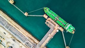 Aerial top view of green oil tanker cargo vessel under cargo ope Stock Images