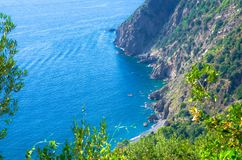 Aerial top view of Guvano Beach, rocks, cliffs and water of Gulf of Genoa, Ligurian Sea, coastline of Riviera di Levante, National royalty free stock images