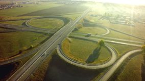 Aerial Top View of highway intersection junction summer morning. With car royalty free stock photography