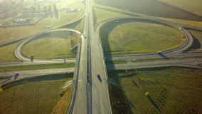 Aerial Top View of highway intersection junction summer morning. With car stock photography