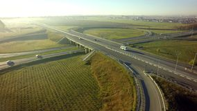 Aerial Top View of highway intersection junction summer morning. With car stock photo