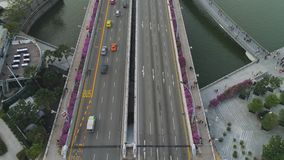 Aerial top view for highway in sunny summer day and footpath with purple flowers bushes. Shot. Above view car traffic on stock video
