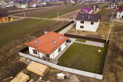 Aerial top view of house with metal shingle roof, brick chimneys and attic windows.  royalty free stock image