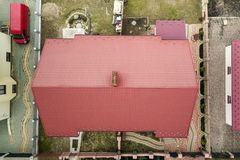 Aerial top view of house metal shingle roof on fenced yard background. Roofing, repair and renovation work.  stock images