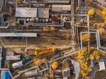 Aerial or top view of industrial zone near energy power plant or factory with warehouses, pipelines and other buildings royalty free stock photography
