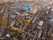 Aerial or top view of industrial zone near energy power plant or factory with warehouses, pipelines and other buildings royalty free stock photo