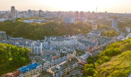 Aerial top view of Kyiv cityscape of Vozdvizhenka and Podol historical districts on sunset from above, city of Kiev Royalty Free Stock Images
