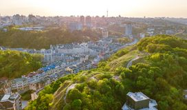 Aerial top view of Kyiv cityscape of Vozdvizhenka and Podol historical districts on sunset from above, city of Kiev Royalty Free Stock Photo