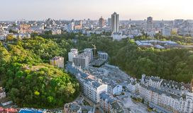 Aerial top view of Kyiv cityscape of Vozdvizhenka and Podol historical districts on sunset from above, city of Kiev Royalty Free Stock Photography