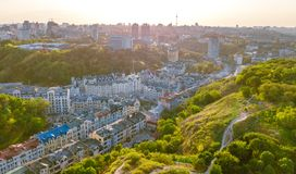 Aerial top view of Kyiv cityscape of Vozdvizhenka and Podol historical districts on sunset from above, city of Kiev Stock Image