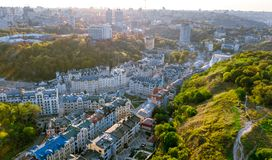 Aerial top view of Kyiv cityscape of Vozdvizhenka and Podol historical districts on sunset from above, Kiev, Ukraine. Aerial top view of Kyiv cityscape of royalty free stock images