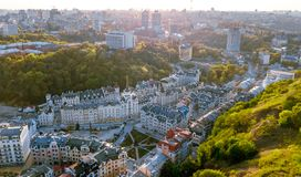 Aerial top view of Kyiv cityscape of Vozdvizhenka and Podol historical districts on sunset from above, Kiev, Ukraine. Aerial top view of Kyiv cityscape of royalty free stock photo