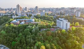 Aerial top view of Kyiv cityscape of Vozdvizhenka and Podol historical districts on sunset from above, Kiev, Ukraine. Aerial top view of Kyiv cityscape of stock photos