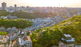 Aerial top view of Kyiv cityscape of Vozdvizhenka and Podol historical districts on sunset from above, Kiev, Ukraine. Aerial top view of Kyiv cityscape of stock image