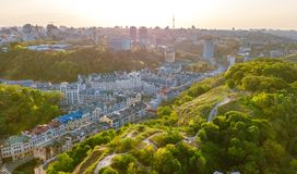 Aerial top view of Kyiv cityscape of Vozdvizhenka and Podol historical districts on sunset from above, Kiev, Ukraine. Aerial top view of Kyiv cityscape of royalty free stock photography