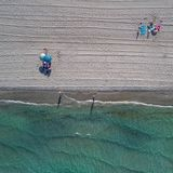 Aerial top view on the La Manga beach. Umbrellas, traces on the sand and turquoise mediterranean sea stock photography